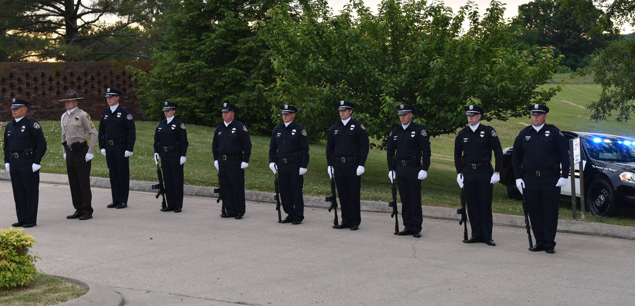 Spring Hill Police Officers standing at attention while participating in the annual Police Memorial