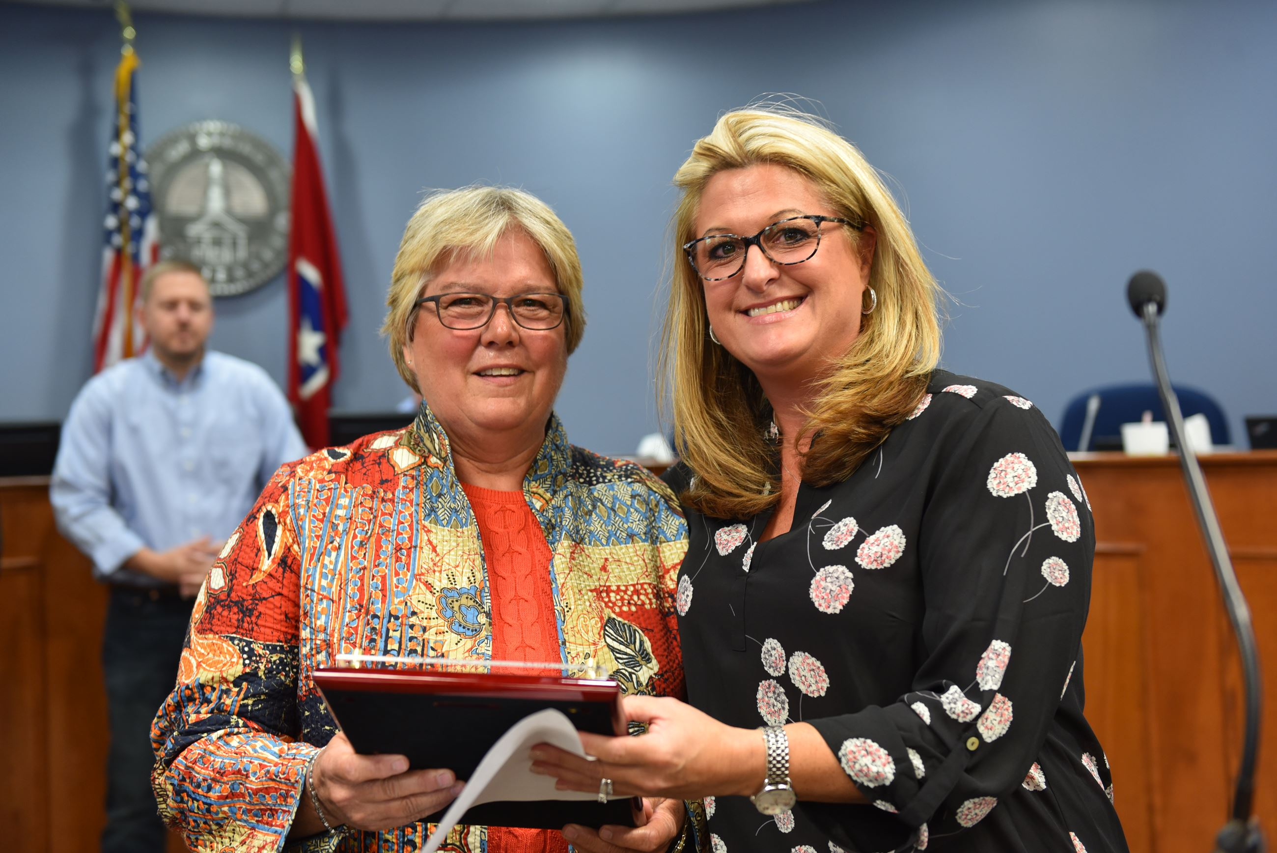 Water Treatment Plant Superintendent Caryl Giles is retiring and was honored by the board with a pla